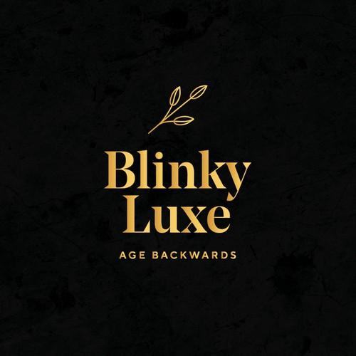 An elegant logo design for a luxury organic face & body serum brand