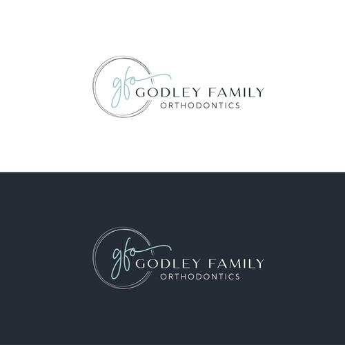 """Logo concept for """"Godley Family Orthodontics'"""""""