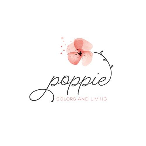 Feminine lflower logoogo wit a poppy flower