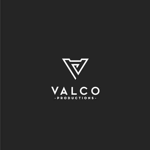 Geometric monogram logo for set design company