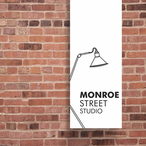 Design the sign for an art and language studio in a historical brick building
