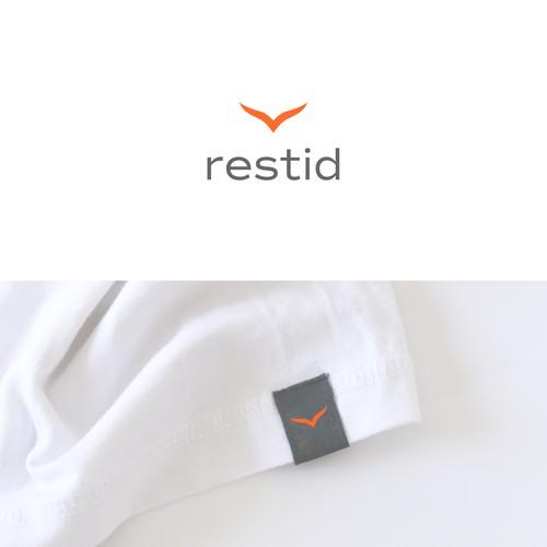 Logo for a travel apparel company