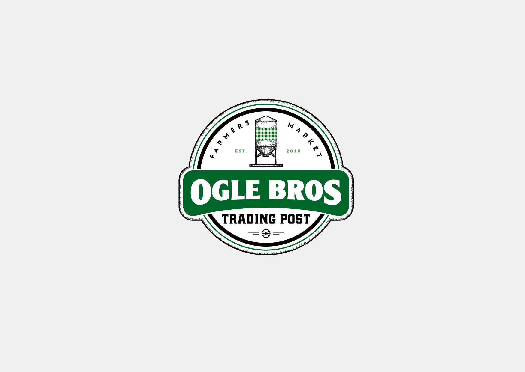 Create a legendary iconic logo and sign element for Ogle Brothers Trading Post
