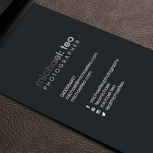 Create a business card for a high end fashion photographer