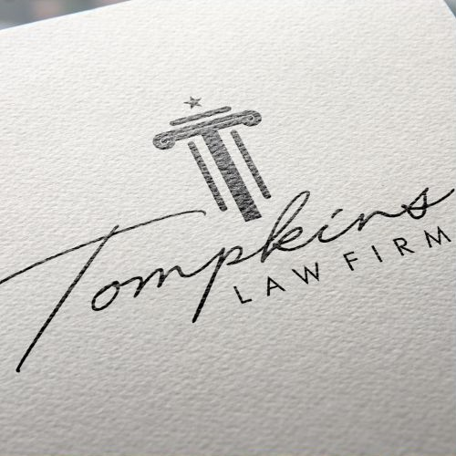 Tompkins Law Firm Logo