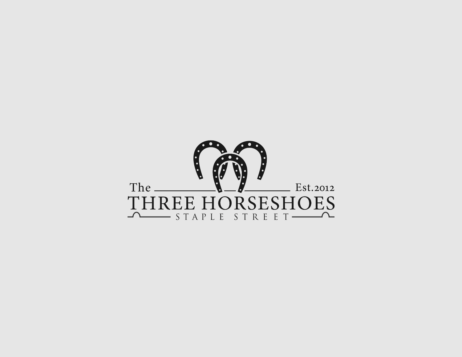 logo for Three Horseshoes
