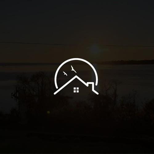 Monochrome real estate - sunset logo