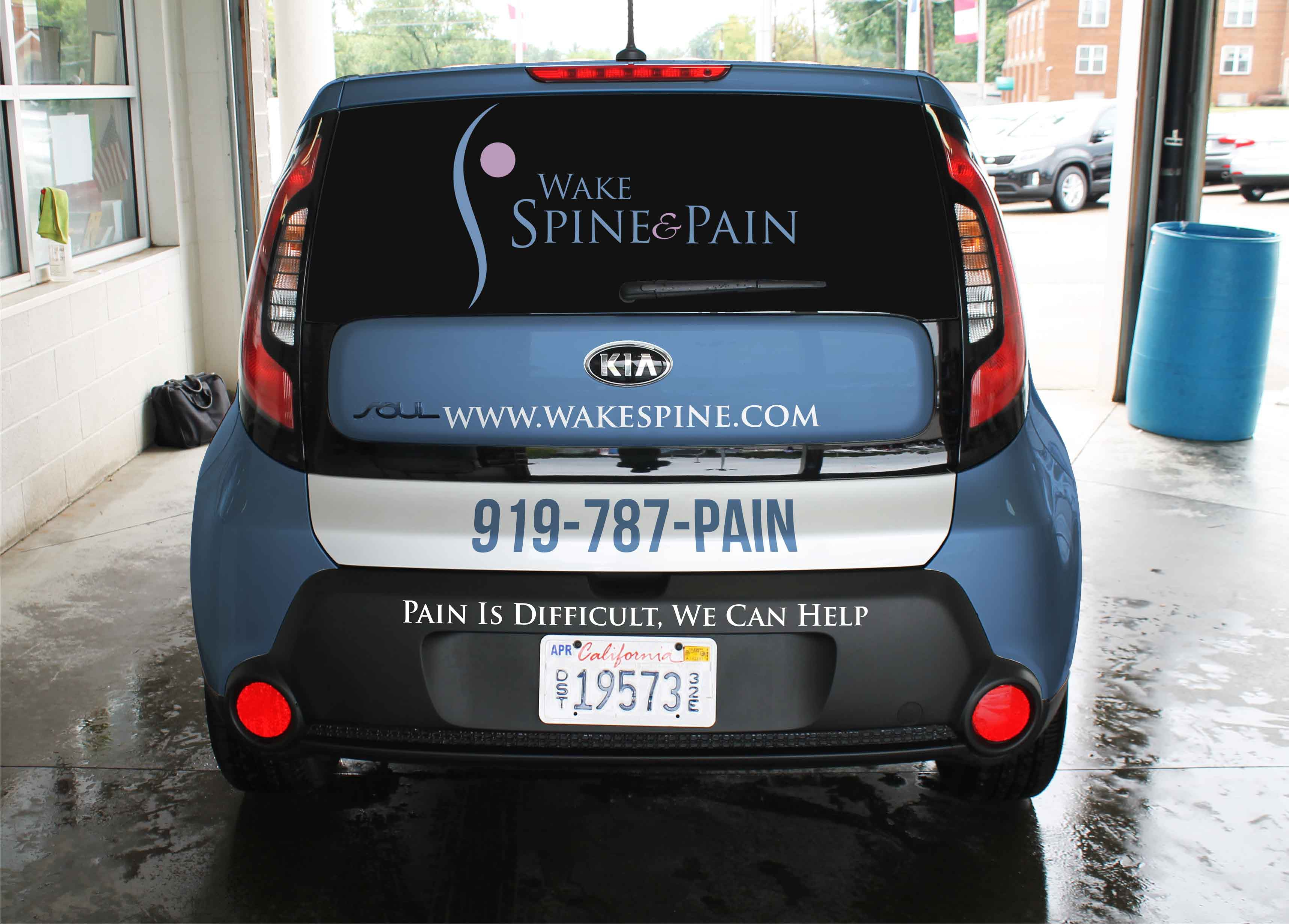 Create a tasteful yet catchy car wrap (Kia sol 2016) design to motivate a person in pain to call us to seek treatment.