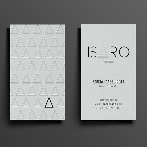 Business card design  with white embossed pattern.