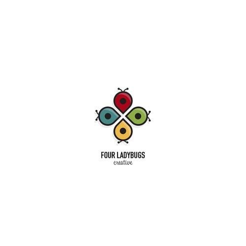 Logo including ladybug and four leaf clover elements