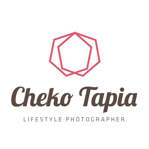 Create the next logo for CHEKO TAPIA