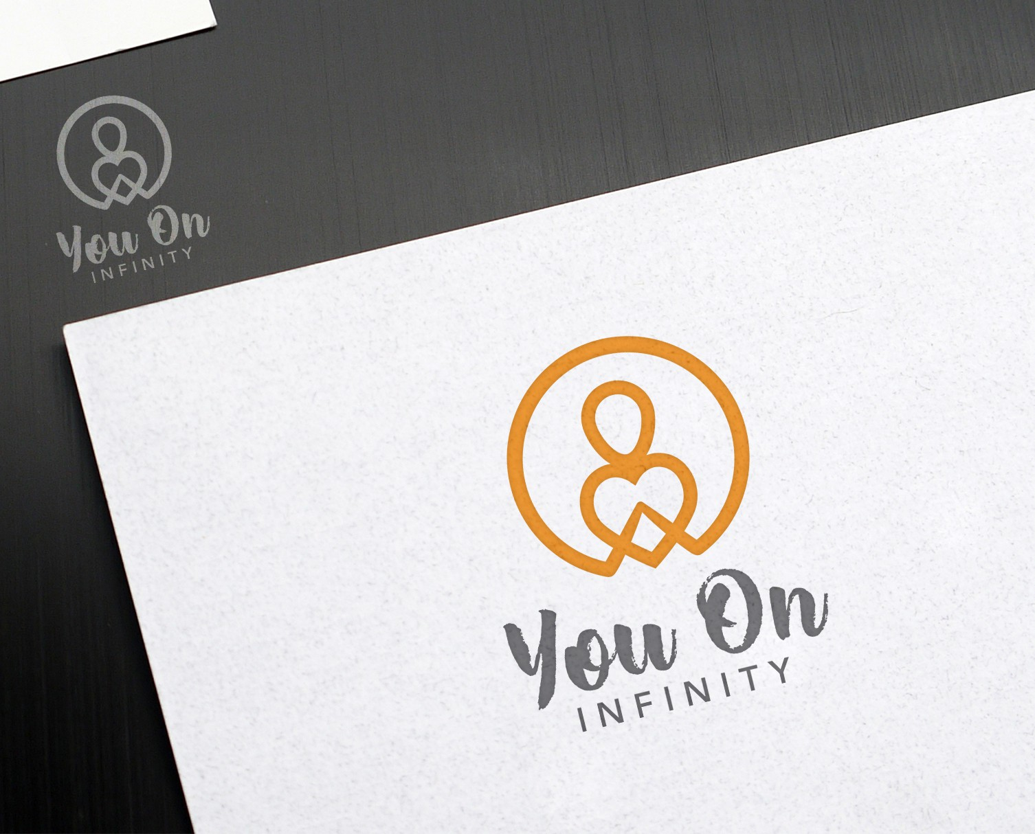 Create a spiritual and grounded logo for You On Infinity
