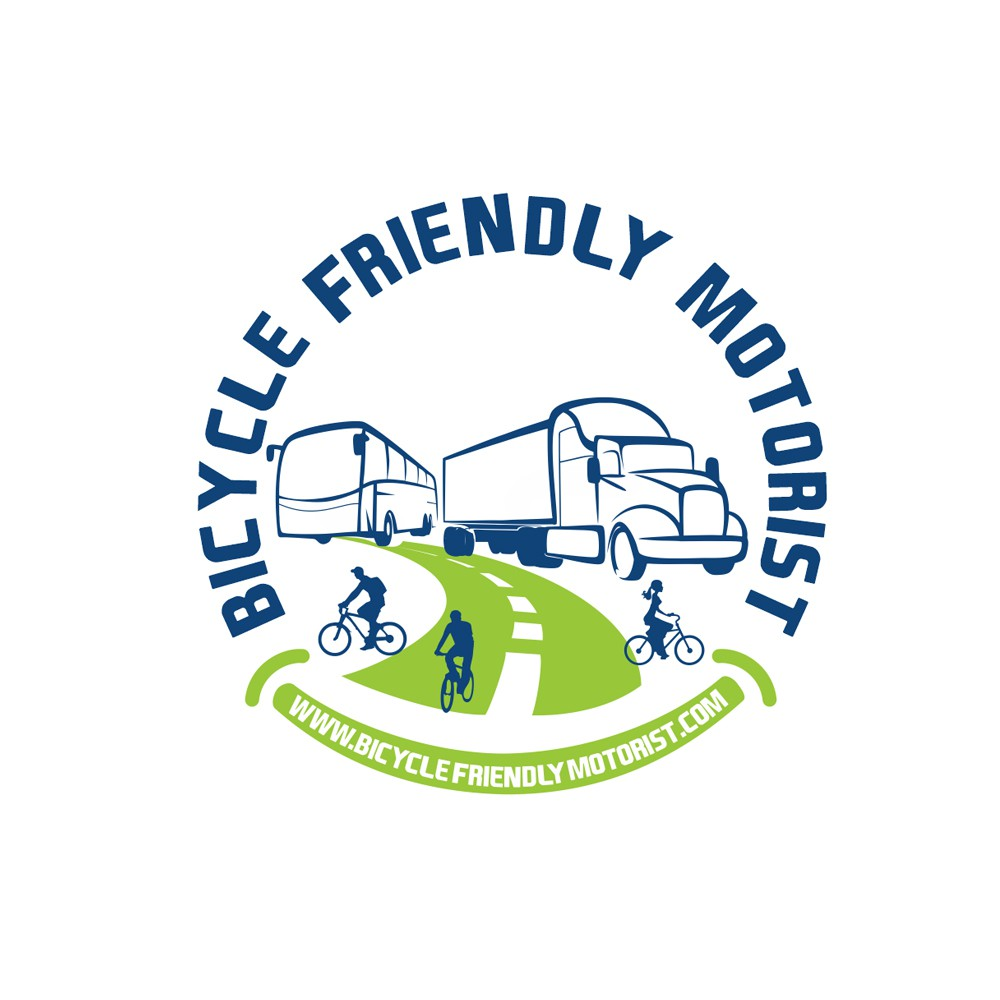 Share The Road: Bicyclist, City Bus, and other Large Vehicles.