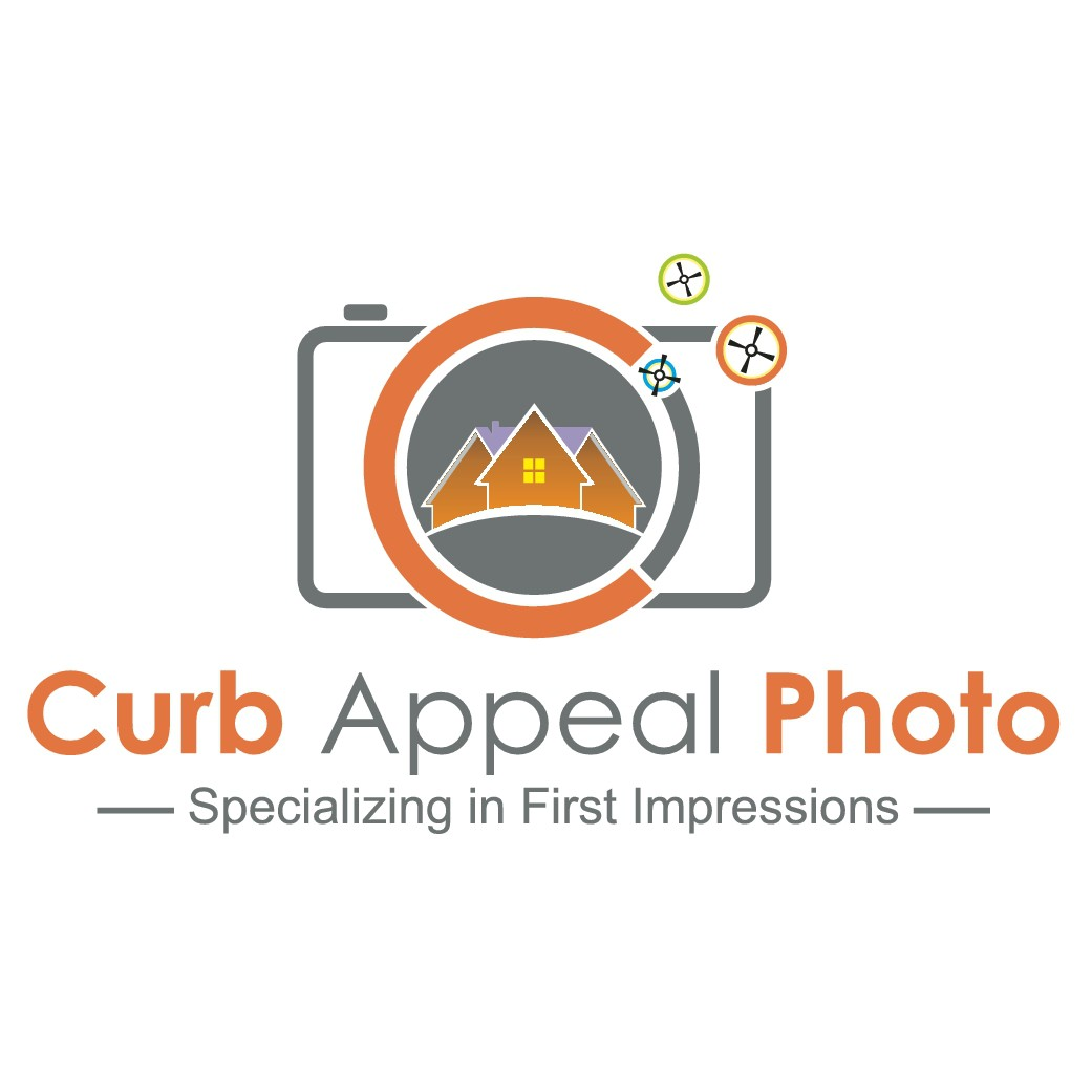Design a fun new logo for an established real estate photographer in Seattle