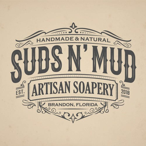 A Badge type logo of Suds N' Mud
