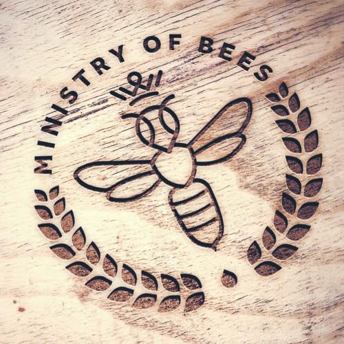 Abstract queen bee logo